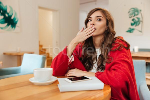 Portré meglepődött nő befogja száját kéz ül Stock fotó © deandrobot