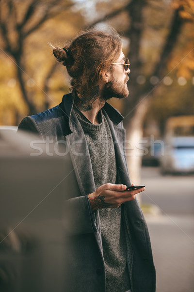 Portrait of a young bearded man Stock photo © deandrobot