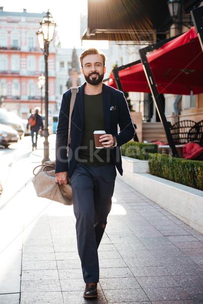 Portrait of a happy bearded man drinking coffee Stock photo © deandrobot