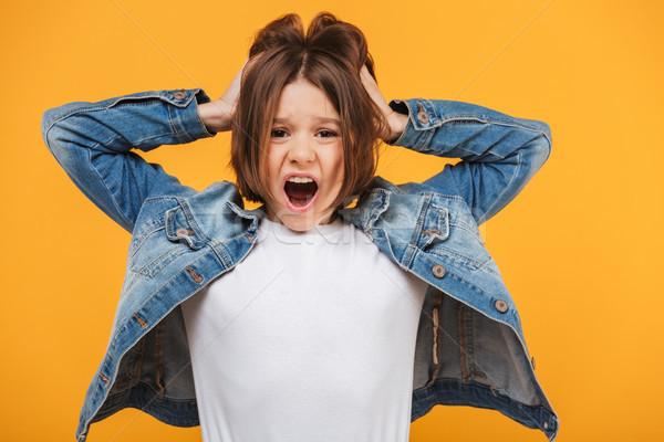 Portré ijedt kicsi iskolás lány sikít néz Stock fotó © deandrobot