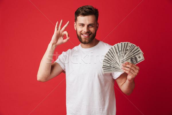 Excité jeune homme argent ok Photo stock © deandrobot
