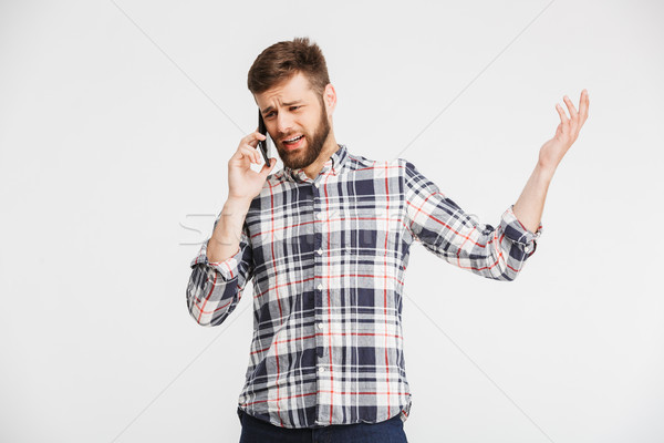Portrait of a confused young man Stock photo © deandrobot