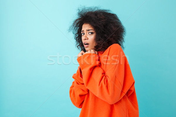 Colorful image closeup of scared woman in red shirt posing on ca Stock photo © deandrobot