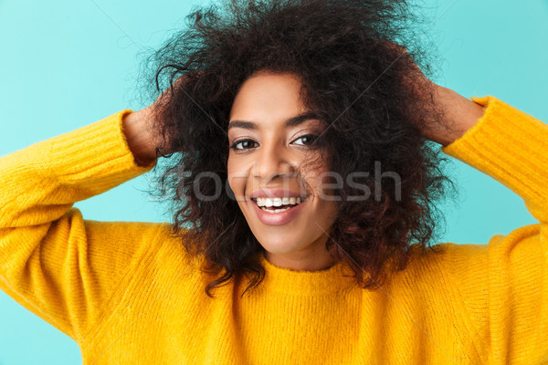 Colorful portrait closeup of curly woman in yellow shirt looking Stock photo © deandrobot