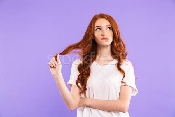 Portret zamyślony młoda dziewczyna stałego odizolowany fioletowy Zdjęcia stock © deandrobot