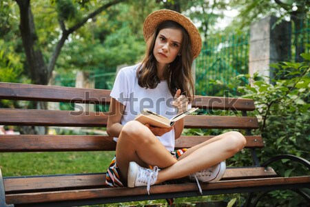 Smiling young girl holding bottle with fizzy drink Stock photo © deandrobot