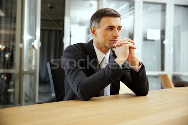 Zamyślony biznesmen posiedzenia biuro działalności pracy Zdjęcia stock © deandrobot