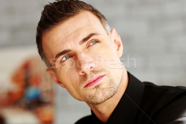 Closeup portrait of a businessman looking up Stock photo © deandrobot