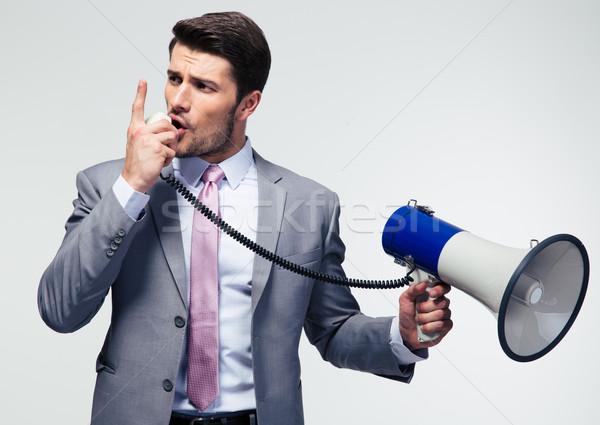 Empresário megafone gritando cinza Foto stock © deandrobot