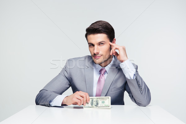 Happy businessman holding us dollar bills Stock photo © deandrobot
