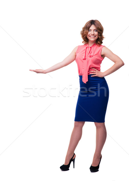 Smiling woman demonstrating something Stock photo © deandrobot