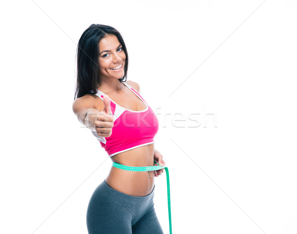 Sporty woman with measuring tape Stock photo © deandrobot