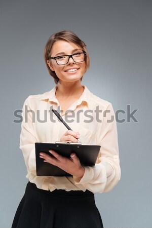 ストックフォト: 笑みを浮かべて · 女性実業家 · 写真 · スマートフォン · 着用