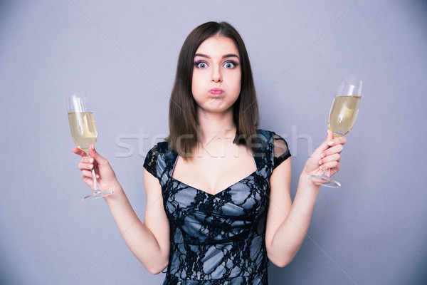 Young beautiful woman holding two glass with champagne Stock photo © deandrobot