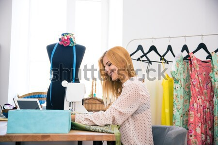 Female tailor using sewing machine Stock photo © deandrobot