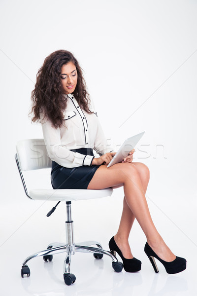 Businesswoman sitting on the office chair with tablet computer  Stock photo © deandrobot