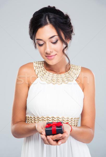 Woman holding jewelry gift box Stock photo © deandrobot