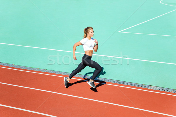 Mulher da aptidão corrida estádio retrato belo mulher Foto stock © deandrobot