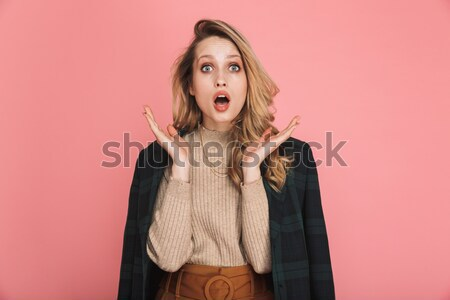 Woman pointing finger up Stock photo © deandrobot