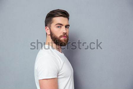 Portrait of indifferent young man Stock photo © deandrobot