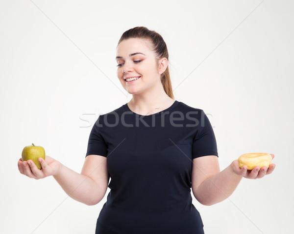 Kövér nő választ fánk alma portré Stock fotó © deandrobot