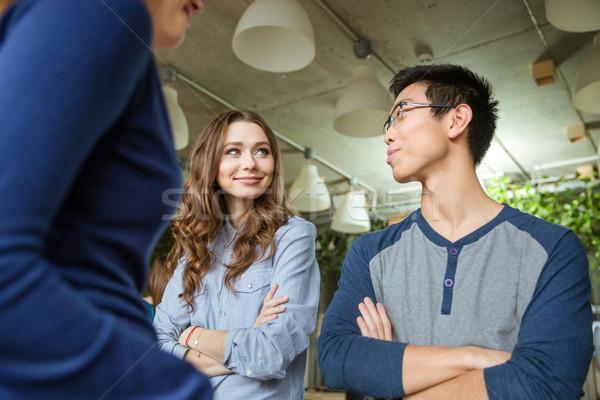 Güzel bir kadın genç Asya adam bakıyor diğer Stok fotoğraf © deandrobot