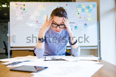 Depressed woman fashion designer drawing sketches on workplace Stock photo © deandrobot