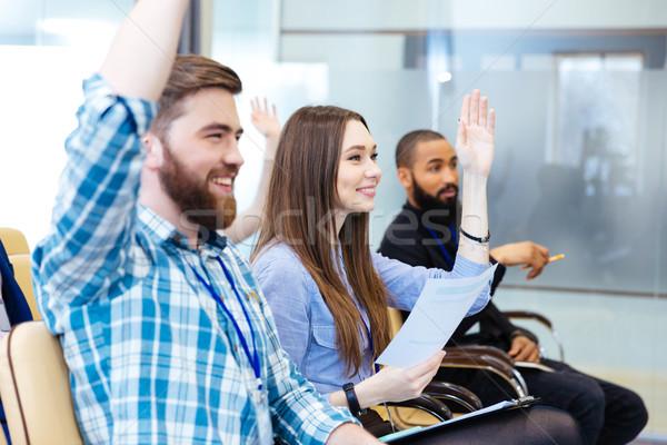 Fiatalok ül felemelt kezek üzlet konferencia derűs Stock fotó © deandrobot