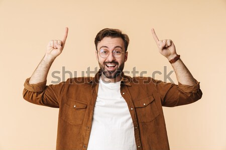 Angry agressive bearded man shouting and frightening Stock photo © deandrobot