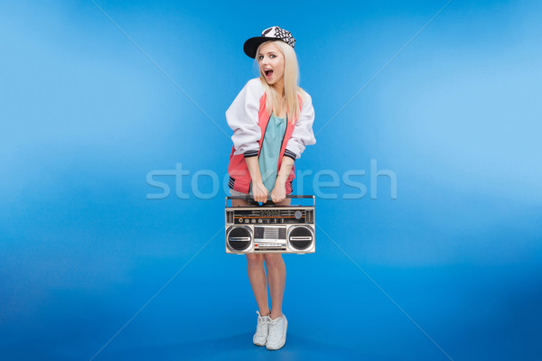 Cheerful female teenager holding retro boom box Stock photo © deandrobot