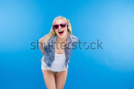 Stylish female teenager licking lollipop Stock photo © deandrobot