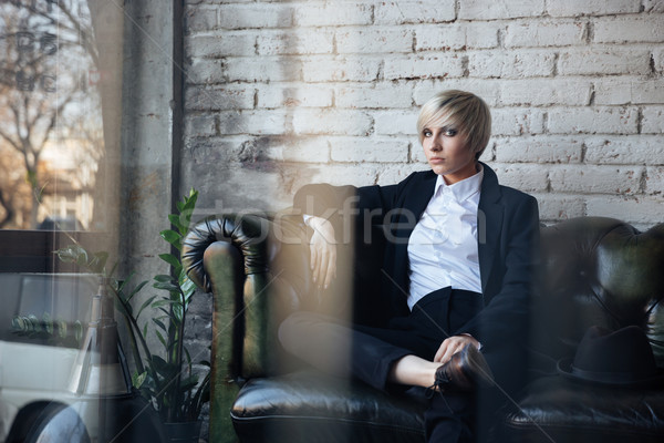 Pretty blonde girl looking seriously in a cafe Stock photo © deandrobot