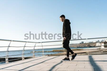 Sportsman preparing for start running on terrace Stock photo © deandrobot