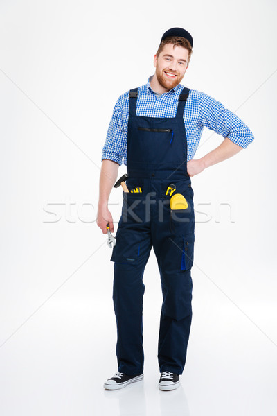 Happy handsome repairman in overall and cap Stock photo © deandrobot