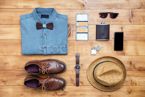 Travel concept shoes, shirt, mobile phone, watch, flask, eyeglas Stock photo © deandrobot