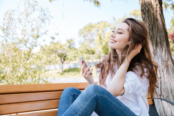 Portré mosolyog lány fülhallgató hallgat zene Stock fotó © deandrobot