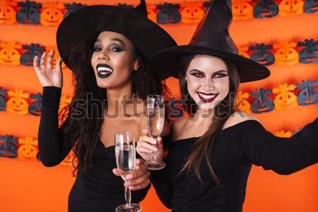 Kettő boldog nők boszorkány halloween jelmezek Stock fotó © deandrobot