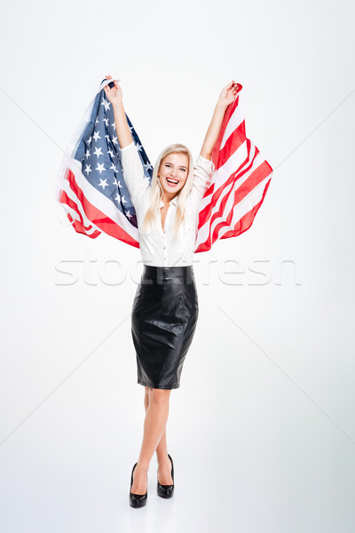 Happy attractive young businesswoman holding big flag of America Stock photo © deandrobot