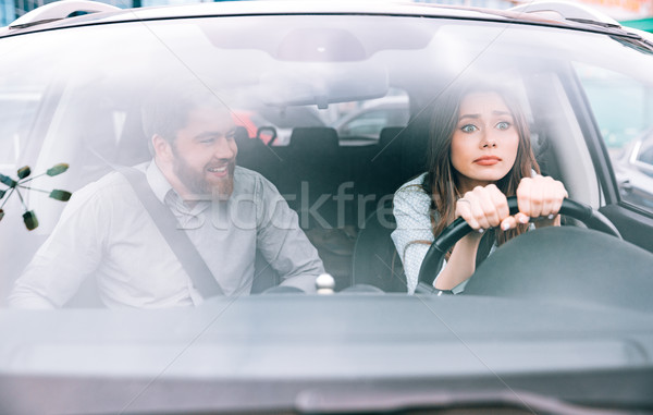 Woman and man in car Stock photo © deandrobot