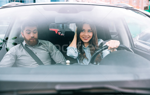 Portrait of couple in car Stock photo © deandrobot