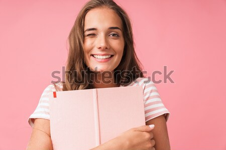 Young attractive woman holding blank billboard with copy space Stock photo © deandrobot