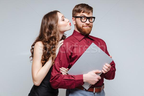 Mulher beijando masculino nerd óculos Foto stock © deandrobot