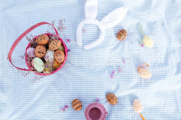 Felső kilátás húsvét ünnep piknik festett Stock fotó © deandrobot