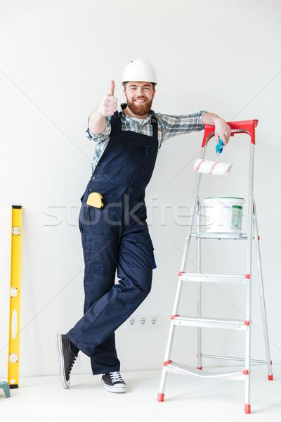 молодым человеком лестнице ремонта Сток-фото © deandrobot