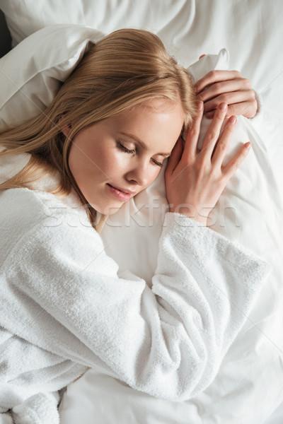 Közelkép portré gyönyörű fiatal nő fürdőköpeny alszik Stock fotó © deandrobot