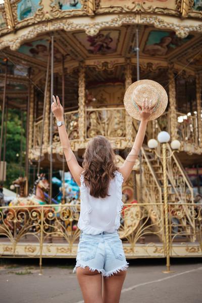 Hátulnézet portré lány áll kezek fiatal lány Stock fotó © deandrobot