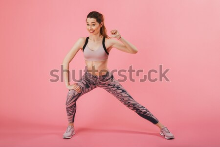 Stock photo: Full length portrait of a motivated fitness woman in sportswear