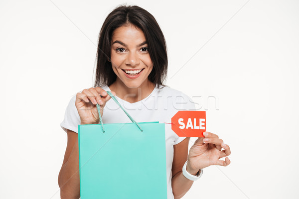 Close up portrait of a happy woman holding shopping bag Stock photo © deandrobot