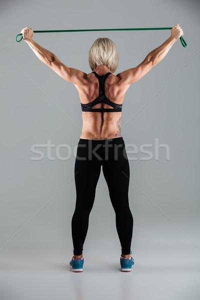 Teljes alakos hátulnézet portré izmos felnőtt sportoló Stock fotó © deandrobot