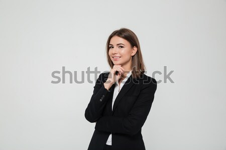 Portrait of young brown-haired businesswoman in suit Stock photo © deandrobot